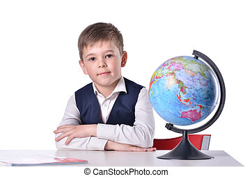 Schoolboy at the desk with a globe on it