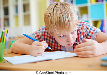 Schoolboy cheating - Elementary learner cheating at lesson