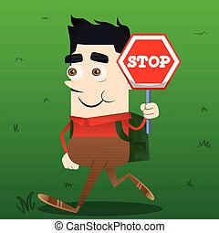 Schoolboy holding a stop sign.