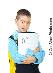 School boy holding good test result with A + isolated on white background