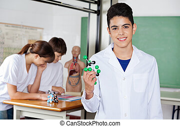 Schoolboy Holding Molecular Structure