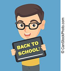 Schoolboy holding tablet with text back to school.