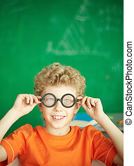 Schoolboy in eyeglasses - Portrait of happy schoolboy in...