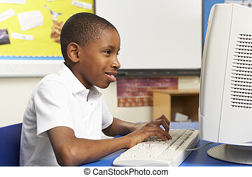 Schoolboy In IT Class Using Computer