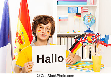 Schoolboy learning German at the light classroom