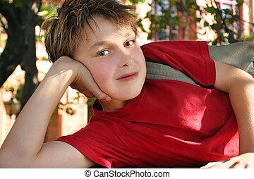 Schoolboy outside school