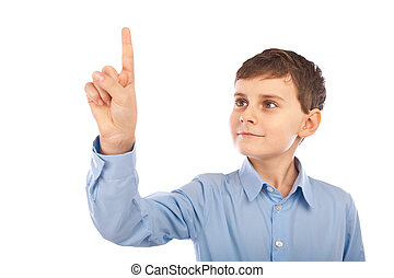 Schoolboy pointing to the copyspace