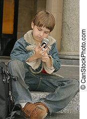 Schoolboy sitting on steps