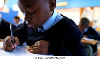 Close-up of schoolboy studying in the classroom at school 4k