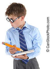 Schoolboy wearing large glasses, holding a book and pencil is looking sideways with much interest.  White background,