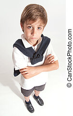 Schoolboy with crossed arms serious