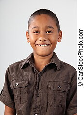 Schoolboy with huge toothy smile - Young boy, 9, with big...