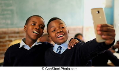 Schoolboys taking selfie in the classroom 4k - Schoolboys ...
