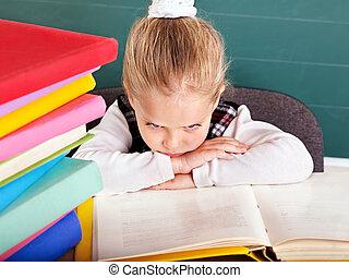 Schoolchild in classroom near blackboard. - Happy...