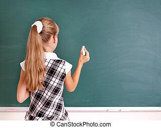 Schoolchild writing on blackboard. - Happy schoolchild ...