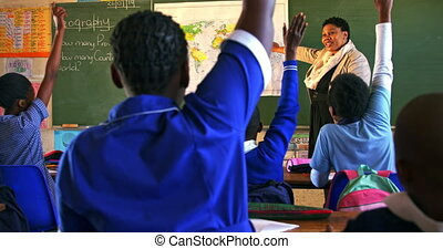 Schoolchildren and teacher in a lesson at a township school 4k