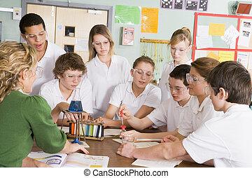 Schoolchildren and teacher in science class