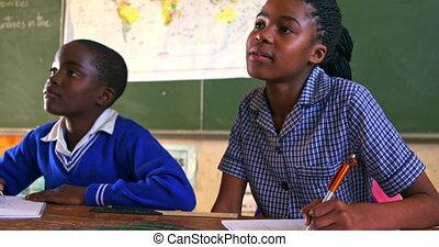 Schoolchildren in a lesson at a township school 4k