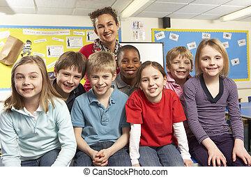 Schoolchildren In classroom with teacher