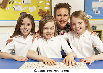 Schoolchildren in IT Class Using Computers With Female Teacher