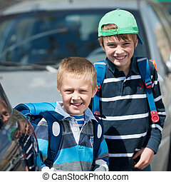 Schoolchildren outdoors - Smiling Schoolchildren waiting for...