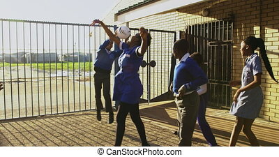 Schoolchildren playing in the playground at a township ...