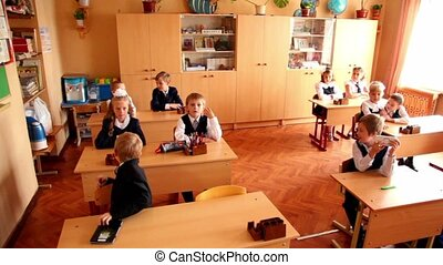 Schoolchildren sits in classroom, panoramic view at School 1349