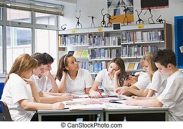 Schoolchildren studying in school library