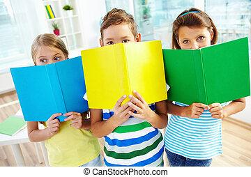 Schoolchildren with books