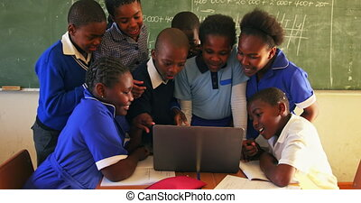 Schoolchildren with laptop in a lesson at a township school 4k