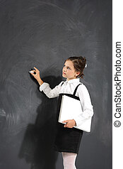 Schoolgirl at the blackboard .