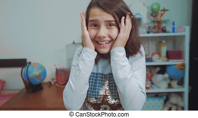 schoolgirl cexperiencing joy happiness surprise. emotion positive concept children. slow motion video. girl teen surprised with joy happiness ecstatic in disbelief emotional expression thrilled. kids girl Surprised concept lifestyle