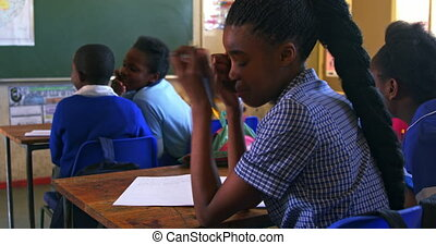 Schoolgirl crying in a lesson at a township school 4k