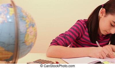 Schoolgirl doing her math homework
