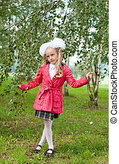 Schoolgirl dressed in a birch forest