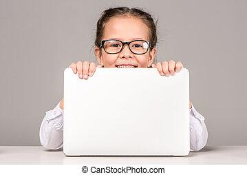 Schoolgirl holding laptop