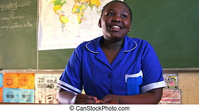 Schoolgirl in a lesson at a township school 4k