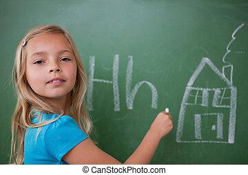 Schoolgirl learning the alphabet