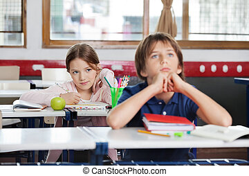 Schoolgirl Looking At Schoolboy