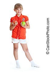 Schoolgirl portrait holding apples isolated