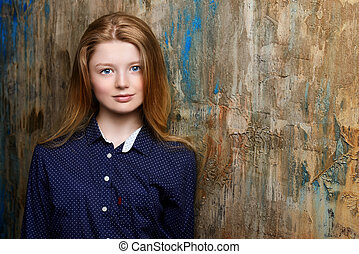 schoolgirl - Portrait of a cute smiling teen girl standing...