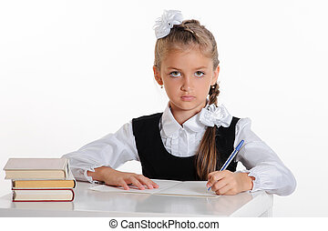 schoolgirl - Portrait of first grader sitting at desk...