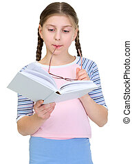 Schoolgirl reads the book on a white