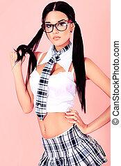 schoolgirl - Sexy student girl posing over pink background.