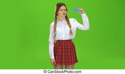 Schoolgirl shows a finger down she is in a skirt and blouse. Green screen