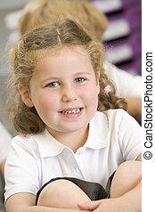 Schoolgirl sitting in primary class