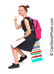 Schoolgirl sitting on a stack of books