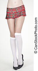 Schoolgirl Skirt and Heels - Close up of woman's legs in...