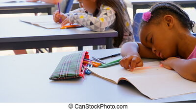 Schoolgirl sleeping on book at desk in the classroom 4k