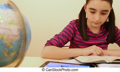 Schoolgirl studying with tablet pc - Schoolgirl reading and...